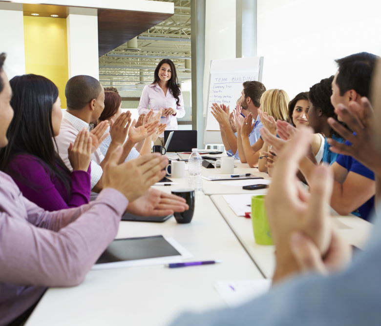Businesswoman impresses colleagues in boardroom meeting presentation